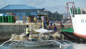Nets-being-unloaded-at-Talibon,-trikes-in-background-resized
