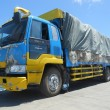 Nets loaded on truck - By looking for spare space on trucks, we can save on costs via our sustainable business model.