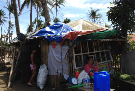 Buntod home patched up after Typhoon Haiyan, showing the vulnerability of local housing.